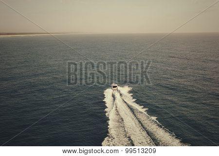 Motor Boat Sailing Towards The Horizon