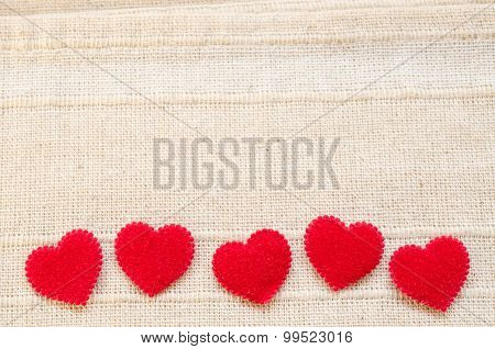 Red Heart Fabric On Vintage Fabric Background.