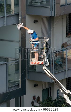 Workman On An Elevated Platform Or Industrial Lift