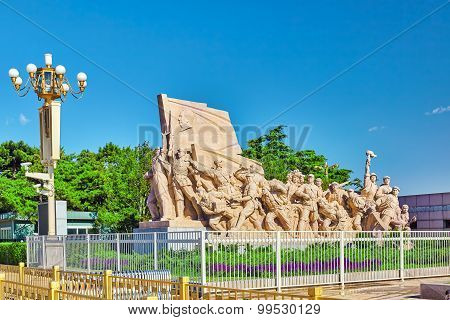 Commemorating statues of workers in struggle in the revolution of China located near mausoleum of Mao Zedong Beijing. China. poster