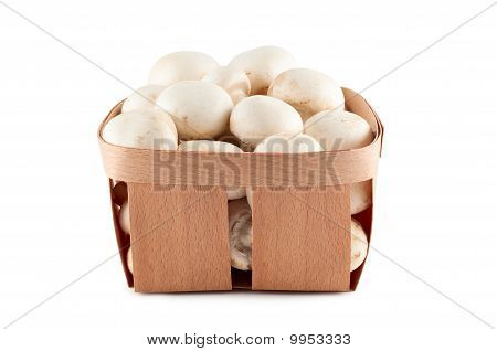 Mushrooms In Box Isolated On White Background.