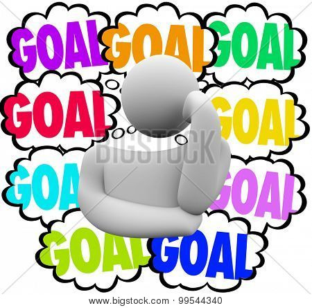 Goal word in thought clouds beside a thinker to illustrate priority setting in handling or working to achieve many missions or objectives