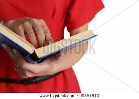 Female Hands Holding Textbook Closeup