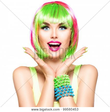 Surprised Beauty Fashion Model Girl with Colorful Dyed Hair, colourful nails. Haircut with fringe. Short Bob Hair style. Portrait of Beautiful woman with Dyed Hair.  Coloring. Colouring hair, make-up
