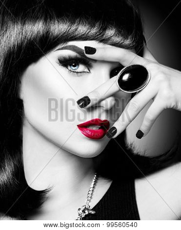Beautiful mysterious brunette lady portrait. Beauty young woman with bob haircut, bright make up, red lips, smoky eyes makeup. Luxury accessories, ring. Black and white