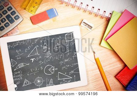 Math equations against students desk with tablet pc poster