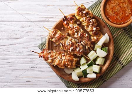 Chicken Satay With A Delicious Peanut Sauce. Horizontal Top View