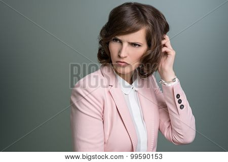 Woman Scratching Her Head With A Puzzled Frown
