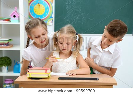Portrait of happy pupils at lesson poster