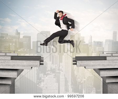 Energetic business man jumping over a bridge with gap concept poster