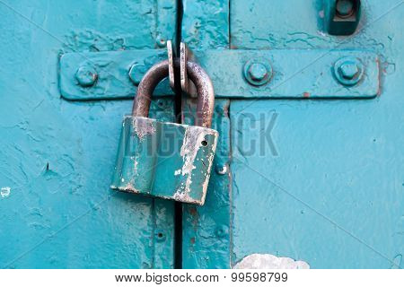 Retro Metal Lock On A Emerald, Cyan Paint Color Door