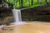 Rock Rest Falls a waterfall in Jennings County Indiana plunges over a cliff and into a natural rocky amphitheater. poster