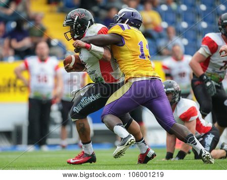 ST. POELTEN, AUSTRIA - JULY 26, 2014: LB Precious Ogbevoen (#13 Vikings) tackles QB Phillip Garcia (#2 Lions) during Silver Bowl XVII.