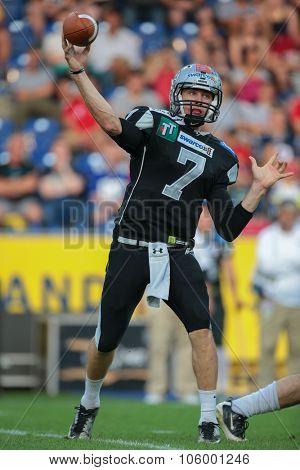 ST. POELTEN, AUSTRIA - JULY 26, 2014: QB John Van Den Raadt (#7 Raiders) passes the ball during Austrian Bowl XXX.