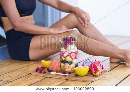 Unrecognizable sportive woman with a healthy breakfast in a mason jar