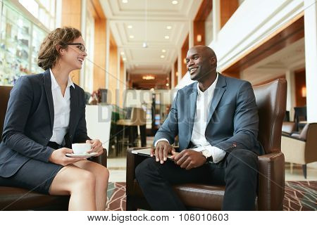 Business People Having A Casual Talk During Meeting At Hotel Lob
