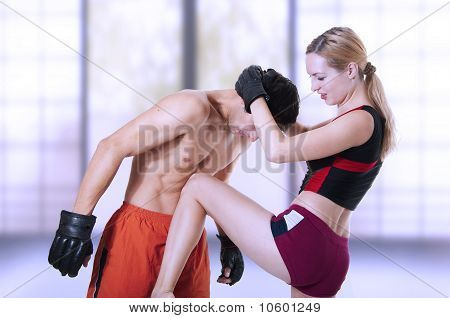 Fight. Woman Knee Kick In Mans Stomach