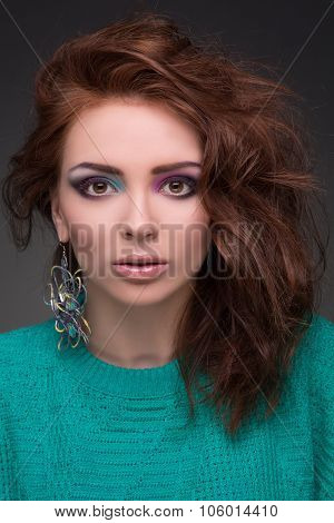 Beautiful young girl with brown hair with make-up