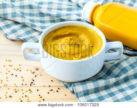 Composition Of Mustard And Mustard Seeds On Wooden Background.