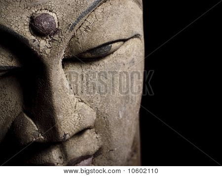 Antique Buddha head statue detail