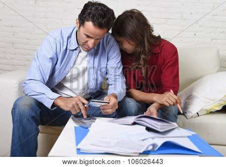 Young Couple Worried And Desperate On Money Problems At Home In Stress Accounting Bank Payments