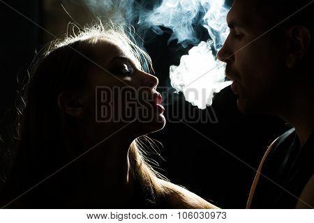 Couple Puff Smoke Into Face