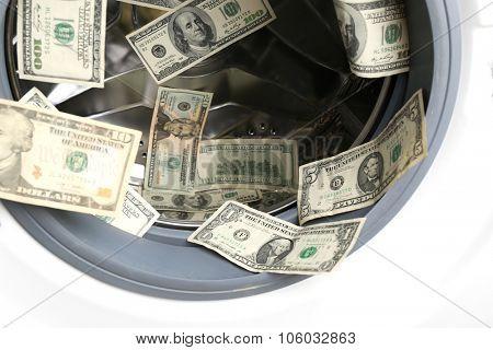 Dirty money in washing machine, close up