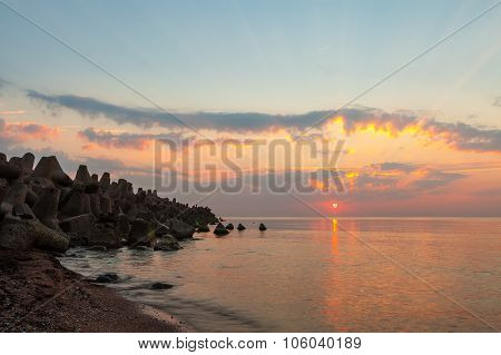 Sunset With Sun And Sunbeams At Sea