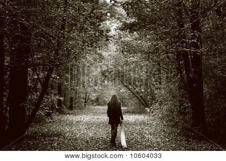 Lonely Sad Woman On The Wood Road