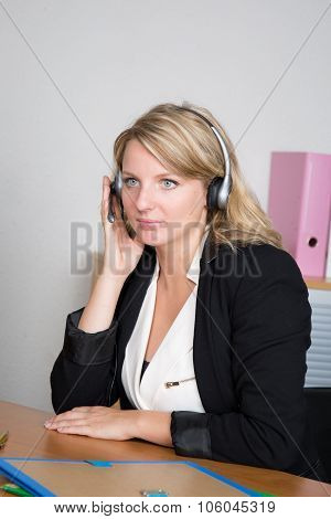Blond Woman Receptionist In A Business Place At Work