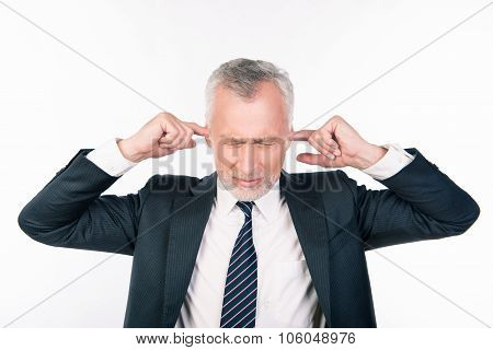 Old Businessman Covering His Ears, Concept Of Business Man Stressed, Headache, Depressed, Pain, Clos
