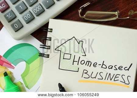 Notepad with Home-based business on the wooden table. poster