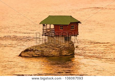 House on rock island in river Drina - Serbia - architecture travel background poster