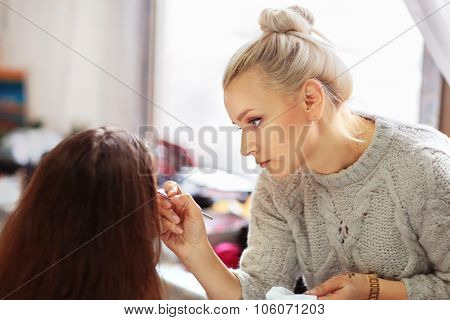 Professional Makeup Artist Apply Makeup Beautiful Girls For The Holiday.