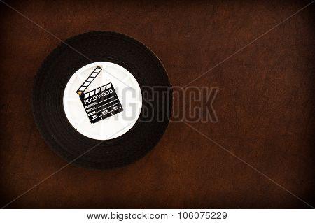 Little Movie Clapper Board On 35 Mm Film Reel