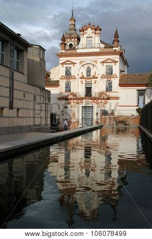 Seville, Spain, October 19, 2015 : Hospital De La Caridad Reflects On A Pool.  The Charity Hospital