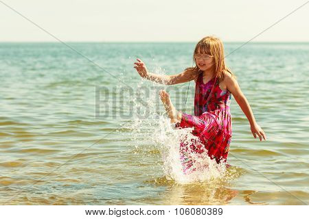 Little Girl Kid Splashing In Sea Ocean Water. Fun