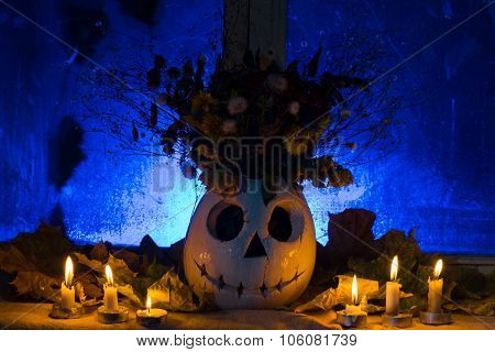 Photo Of Pumpkin Of A Vase With The Flowers For A Holiday Halloween.