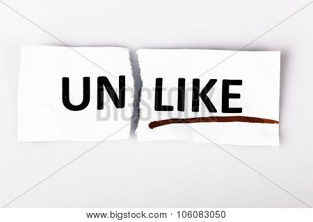The Word Unlike Changed To Like On Torn Paper