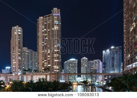 Miami Skyline At Night Along The Miami River