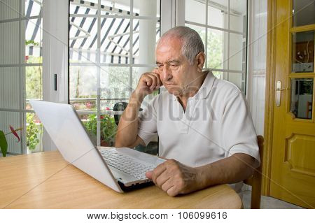 Senior Man Learning To Use A Laptop