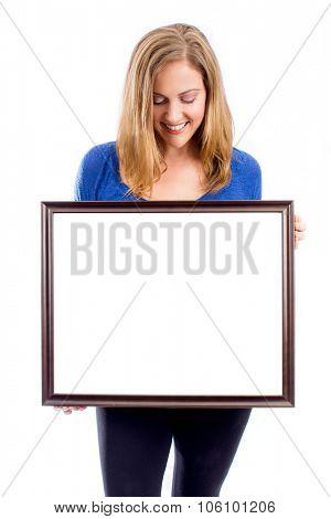 Woman holding empty white framed sisn - room for copy