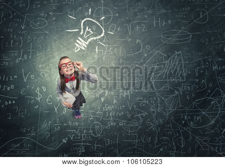 Wideangle picture of funny schoolgirl with paper plane in hand