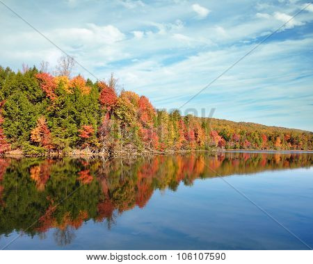 Bright fall colors reflecting in the Bays Mountain Lake in Kingsport, Tennessee