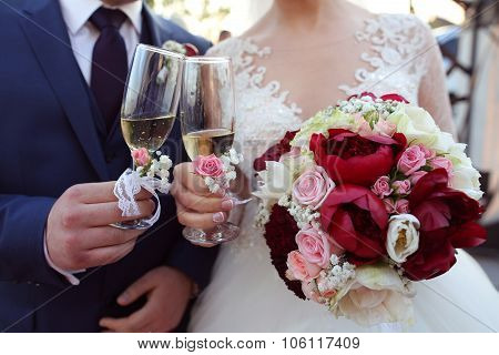 Bridal Couple Toasting Glasses Of Champagne