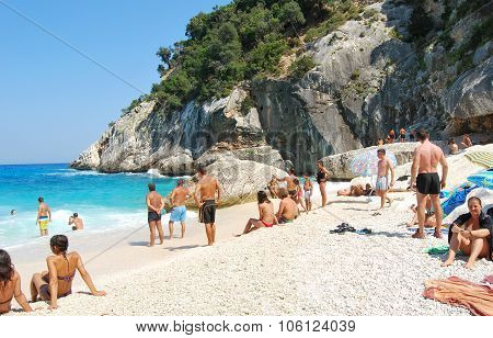 Cala Goloritze', Italy-AUGUST 23: Unidentified people in white beach with blue crystal sea and waves