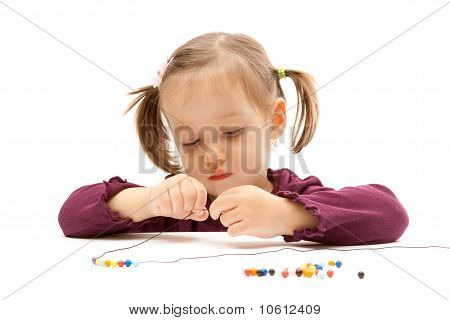 Young Little Girl Beading On White Background