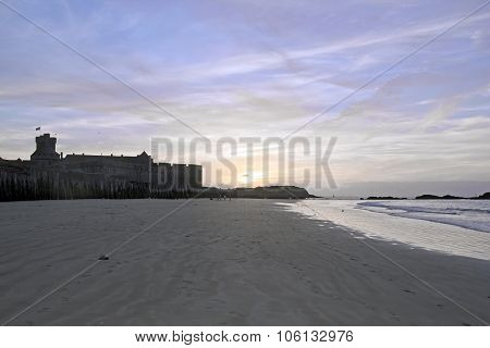 Sunset in summer on the beach and the city of St Malo (Brittany France)