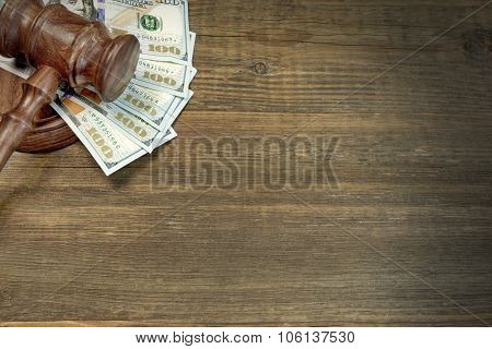 Judges Or Auctioneer Gavel And Money On The Wooden Table