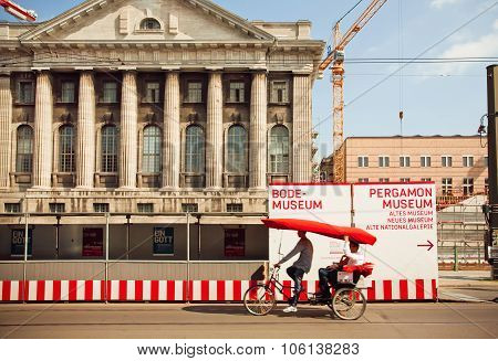 Rickshaw On The Bike Carries Tourists Through The Museum Island Of Berlin
